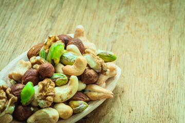 Varieties of nuts: cashew, pistachio, almond.