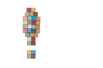 multicolor stone exclamation sign