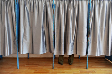 Man inside a voting booth