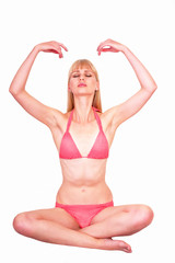 Young woman practicing Pranayama yoga breathing