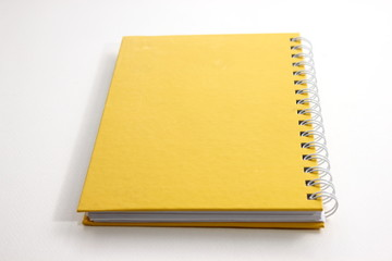 yellow notebook with a white background.