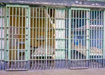 Prison bars and beds within the cells