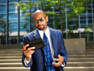 cool professional business executive working with tablet