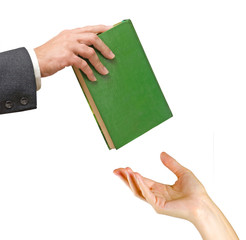 Man giving a book to woman