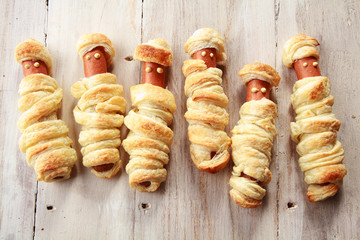 Six Weiners Wrapped in Pastry to Look Like Mummies