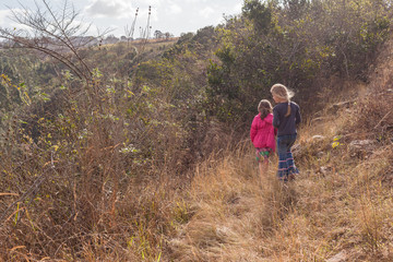 Young Girls Exploring Nature Reserve Outdoors