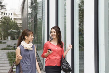 Modern building , Two young women