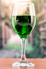 glass with green liquid cocktail