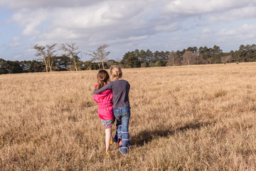 Young Girls Walking Holding Grass Landscape Terrain