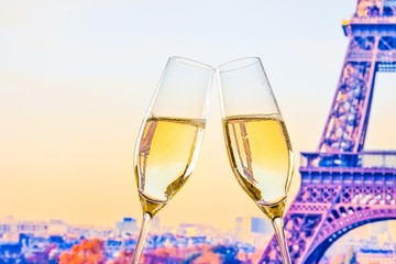 champagne flutes on blur tower Eiffel background