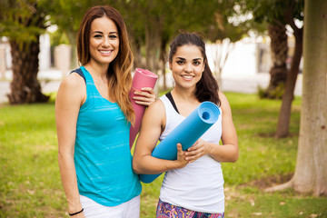 Beautiful girls with yoga mats