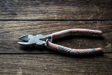 old diagonal pliers on a wooden