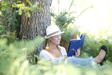 Woman in park enjoying novel