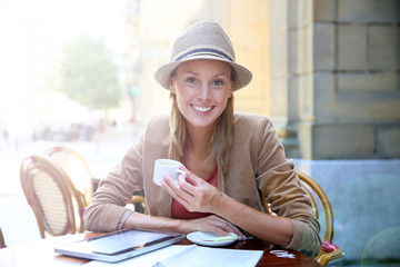 Young woman in the city sitting at coffee shop