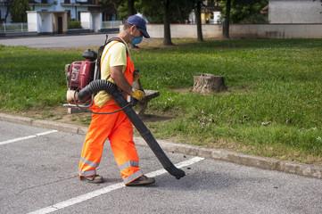 Man using electric leaf blowers