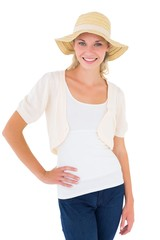 Attractive young blonde smiling at camera in sunhat