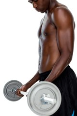 Determined fit shirtless young man lifting barbell