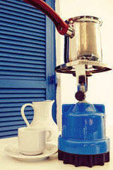 Coffee pot on a primus stove on veranda. Coffee concept.