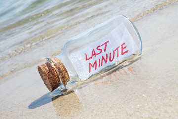 "Message in bottle ""Last minute"". Creative summer break concept."