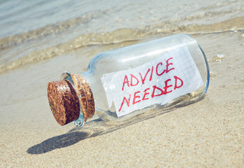 "Message in a bottle ""Advice needed"". Creative help concept."