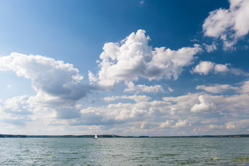 Lake and cloudscape and sailboat