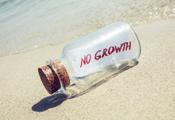 """Creative business concept. Bottle with message """"No growth"""""""