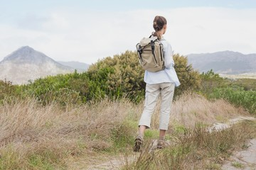Rear view of a hiking young woman