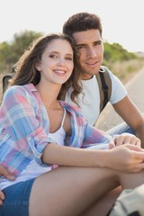 Couple sitting on countryside road