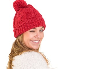 Happy blonde in winter clothes winking