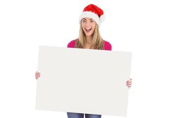 Festive blonde holding large poster