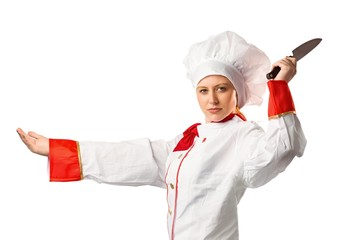 Pretty chef slicing with knife