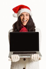 Smiling woman holding a laptop