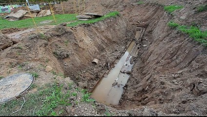 pipes filled with water in an earthen pit