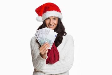 Woman holding money towards herself