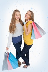 Two beautiful women holding shopping bags