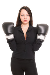 Young brunette wearing boxing gloves