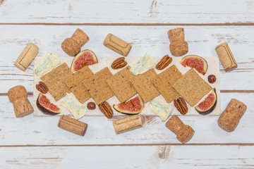 Cheese and crackers with wine corks