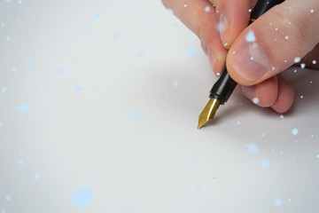 Composite image of hand writing with fountain pen