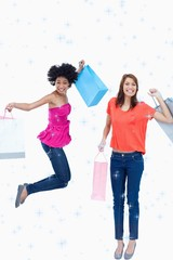 a teenage girl jumping with her shopping bags