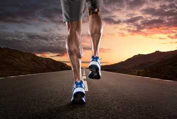 Close up of athlete running on the empty road