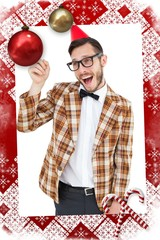Composite image of geeky hipster in party hat pointing