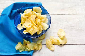 potato chips inside blue bowl