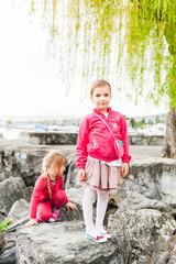 Cute little girl having fun outdoors