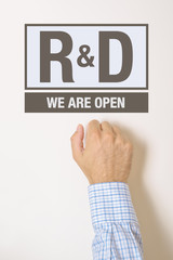 Businessman knocking on Research and Development department door