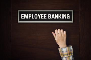 Hand is knocking on Employee Banking door