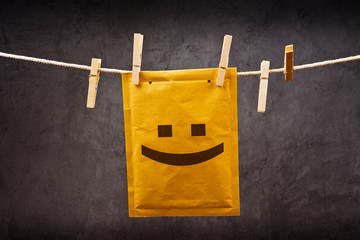 Happy face emoticon on mail Envelope