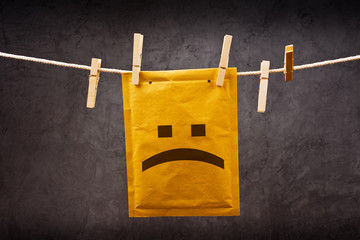 Sad face emoticon on mail Envelope