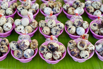boiled quail eggs with soy sauce, street food in Thailand