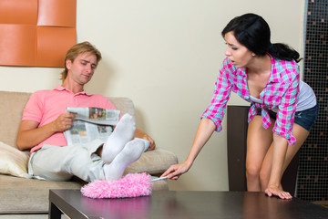 Young woman cleaning the apartment
