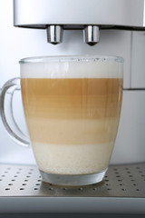 fresh brewed latte macchiato from a coffee machine